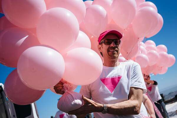 Patrick Carney brings in dozens of balloons for the Pink Triangle Ceremony at Twin Peaks in San Francisco, Calif., on Saturday, June 23, 2018.