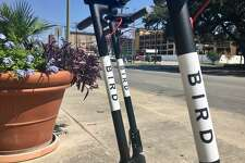 """Electric scooters called """"Birds"""" appeared in San Antonio Friday morning. They are available to rent for short rides through smartphones. (S. M. Chavey / San Antonio Express-News)"""
