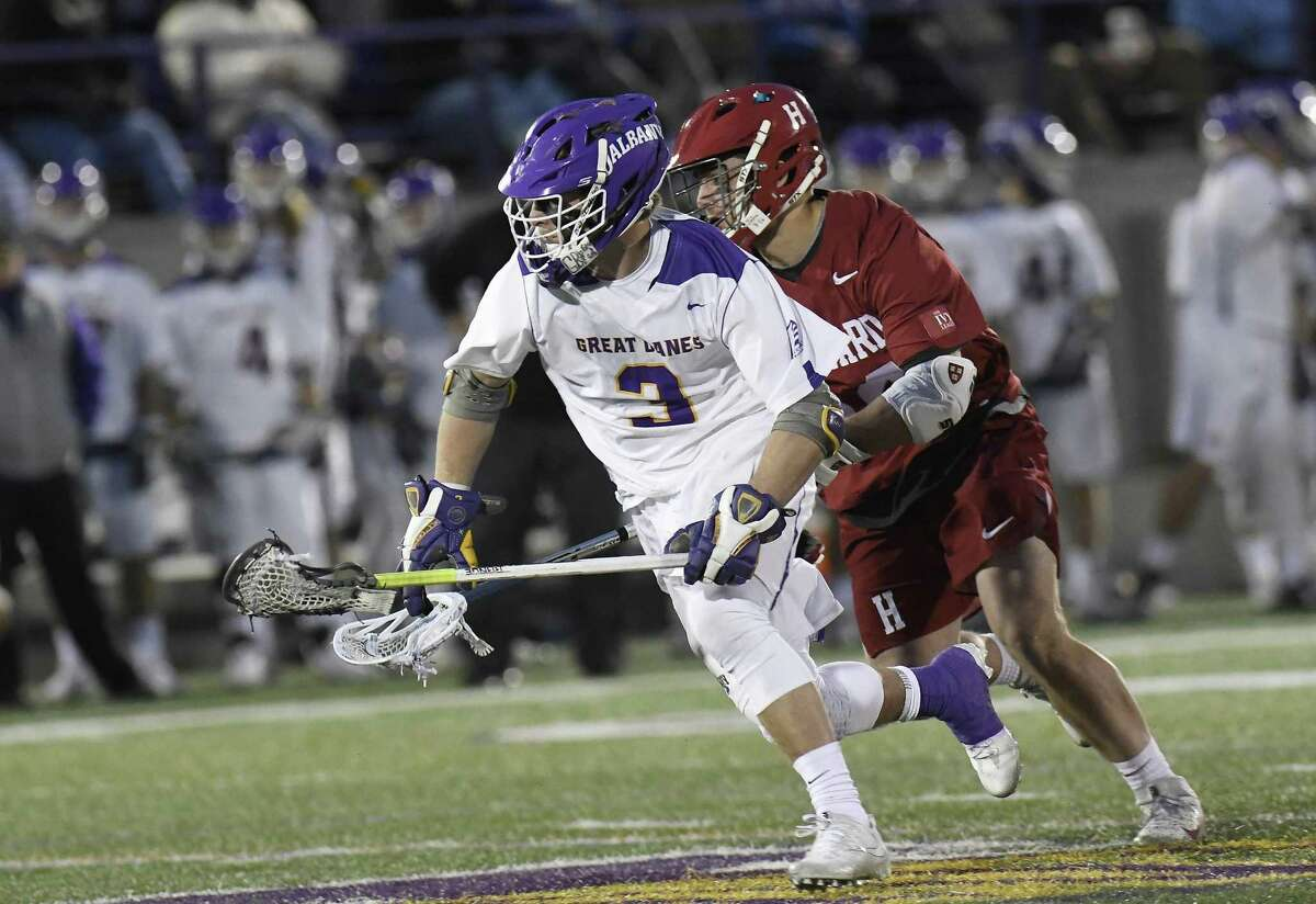 Albany's TD Ierlan (3), the top faceoff man in the country, is transferring to Yale this fall and will be eligible immediately.