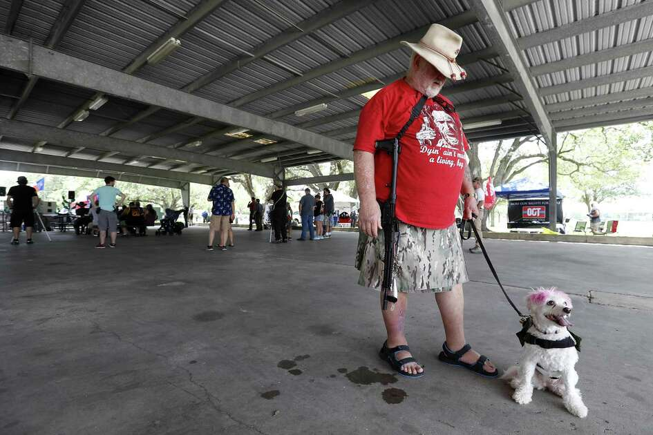 "Mark Crampton, of Galveston, holds his long rifle with his dog ""Maggie Me Love"" during  a pro-gun rally, at Runge Park Saturday, June 23, 2018, in Santa Fe.  This Is Texas Freedom Force (TITFF) invited the public in Santa Fe & surrounding areas to join the discussion about arming teachers and school staff.  ( Karen Warren  / Houston Chronicle )"