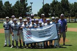 The Mid City 10-12 year old all-stars pose with the championship banner after winning the Little League Texas West District 3 title with an 8-2 victory over Northern Saturday at Butler Park. Photo by Christopher Hadorn