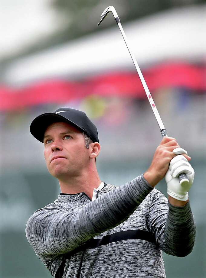 Paul Casey watches his shot on the 16th hole during the third round at Travelers Championship on Saturday in Cromwell. Photo: Catherine Avalone / Hearst Connecticut Media / New Haven Register