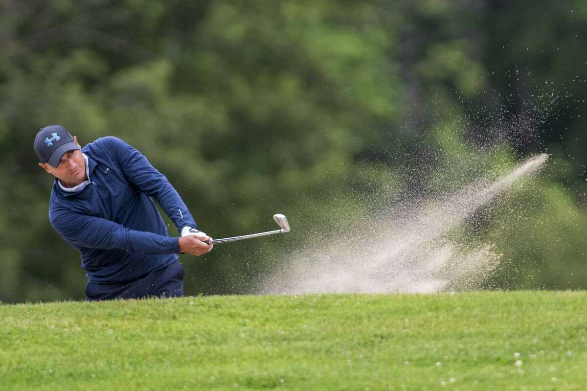 Joe Nethercott hits out of a trap on the 1st hole during the Town of Greenwich Men's 74th annual Golf tournament played at Griffith E. Harris golf course, Greenwich, CT. Saturday, June 23, 2018.