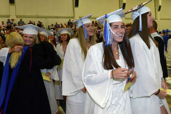 Graduates including Zoe Lash celebrate the 60th annual Wilton High School Commencement Exercises for the Class of 2018  Saturday, June 23, 2018 at 5:00 p.m. at the school in Wilton, Conn.