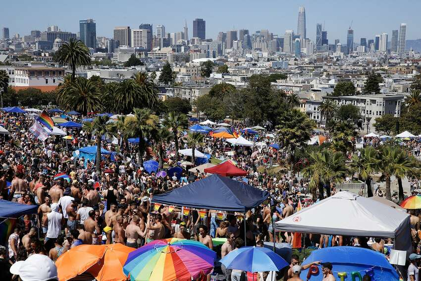 Thousands of people at Dolores Park during the festivities before Pride and the Dyke March, Saturday, June 23, 2018, in San Francisco, Calif.
