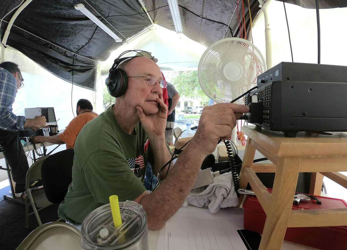 Lloyd Swartz tunes his radio during the national Amateur Radio Field Day exercise by members of the San Antonio Radio Club at Shavano Park City Hall on Saturday, June 23, 2018. The public event was designed to educate the public about ham radios and their reliability during natural disasters.