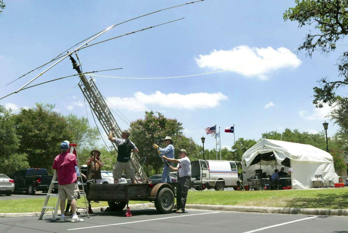A crew raises a beam antenna during the national Amateur Radio Field Day exercise by members of the San Antonio Radio Club at Shavano Park City Hall on Saturday, June 23, 2018. The public event was designed to educate the public about ham radios and their reliability during natural disasters.