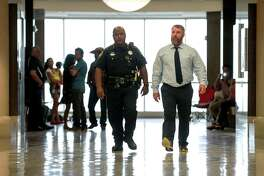Terry Thompson, front-right, walks past family and friends of John Hernandez on his way back to the courtroom as the jury deliberates for a third day in his murder trial, Saturday, June 23, 2018, in Houston. Thompson and his wife, Chauna Thompson, a former Harris County Sheriff's Office deputy, were charged with murder after Hernandez died following an altercation at a Denny's restaurant in May 2017.  ( Jon Shapley / Houston Chronicle )