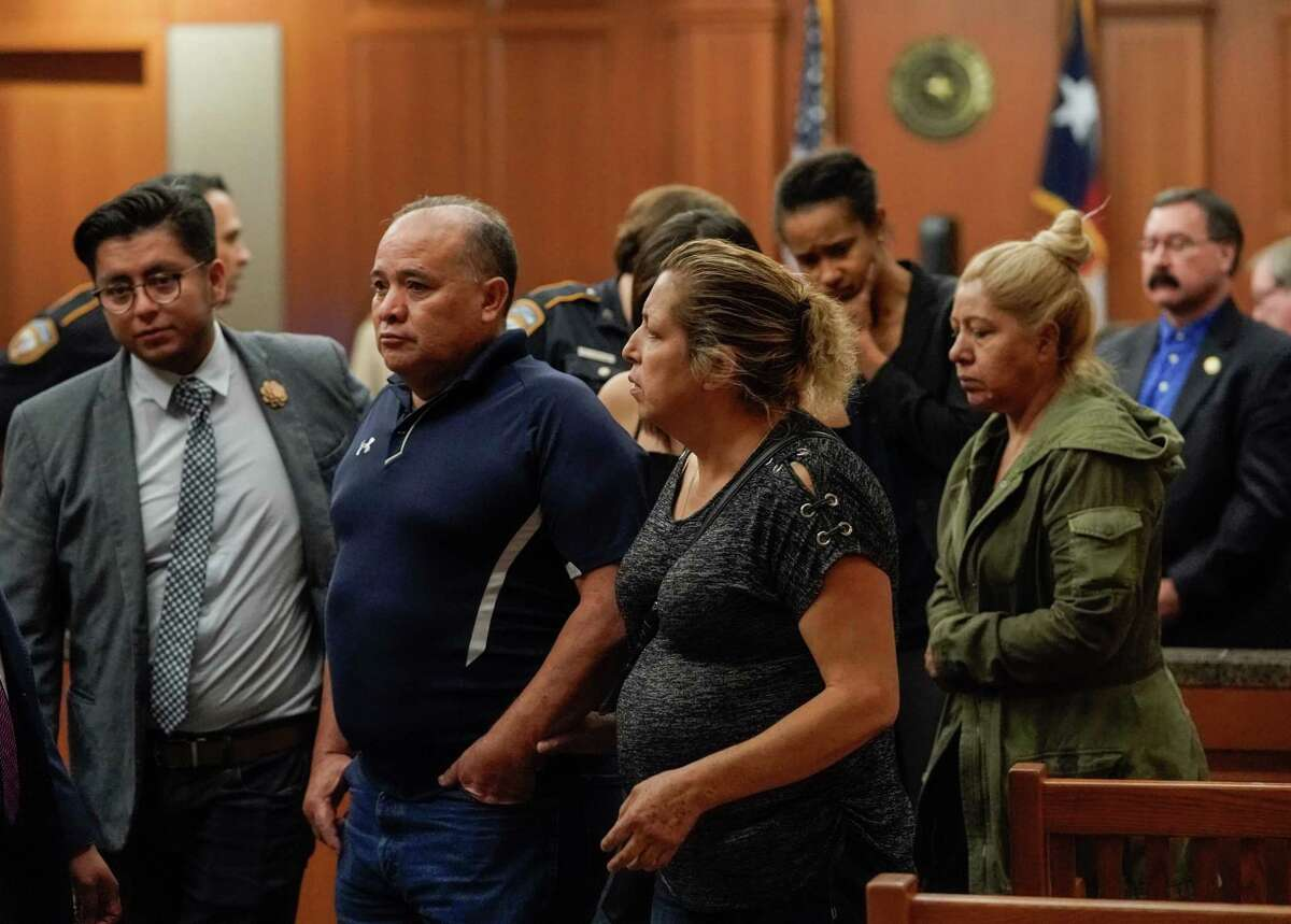 Ignacio Hernandez, center, and his wife, Maria Hernandez, right, the parents of the late John Hernandez and their supporters leave from the court after a mistrial was declared for Terry Thompson, who was accused of fatally choking John Hernandez, shown Saturday, June 23, 2018. Terry Thompson was charged with murder in the chokehold death of John Hernandez at a Denny's in May 2017. His wife, Chauna Thompson, who was then a Harris County Sheriff's deputy, is also charged with murder, accused of helping to hold Hernandez down.