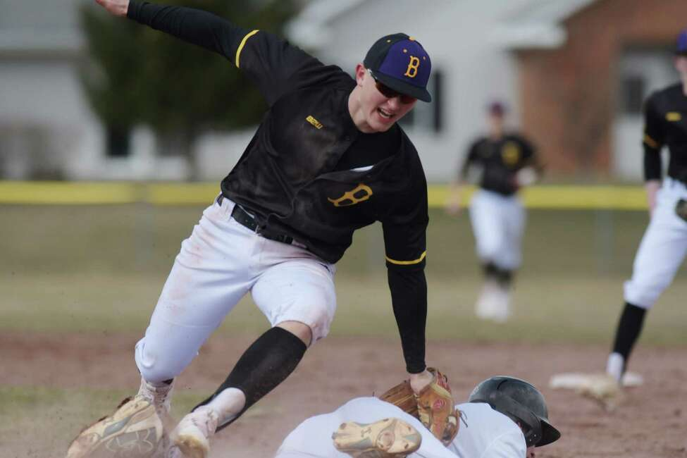 Luke Gold of Ballston Spa High School tags out Jack O'Leary of Christian Brothers Academy in between first and second during the Christian Brothers Academy and Ballston Spa High School baseball game on Thursday, April 5, 2018, in Albany, N.Y. (Paul Buckowski/Times Union)