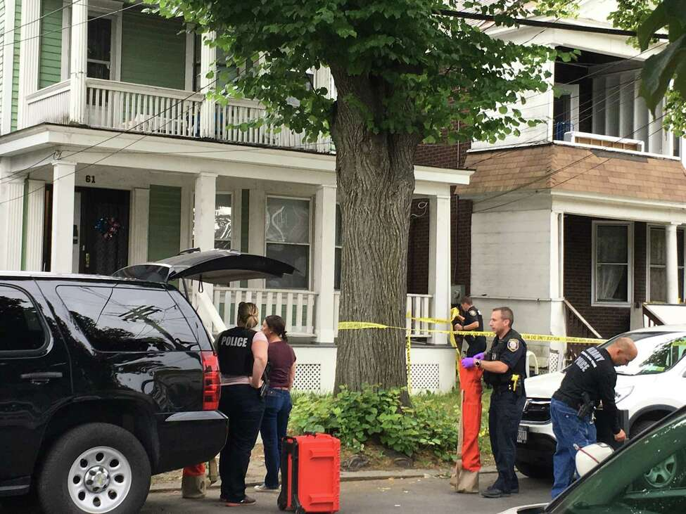 Police and crime tape outside the residence at 61 Partridge St. in Albany in June 2018 where police said Schuyler Lake stabbed his mother and uncle. (Madison Iszler / Times Union)