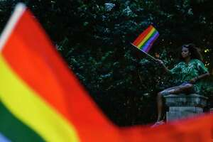 A person waves a pride flag as thousands of people fill downtown for the 40th annual Pride Houston festival and parade Saturday, June 23, 2018.