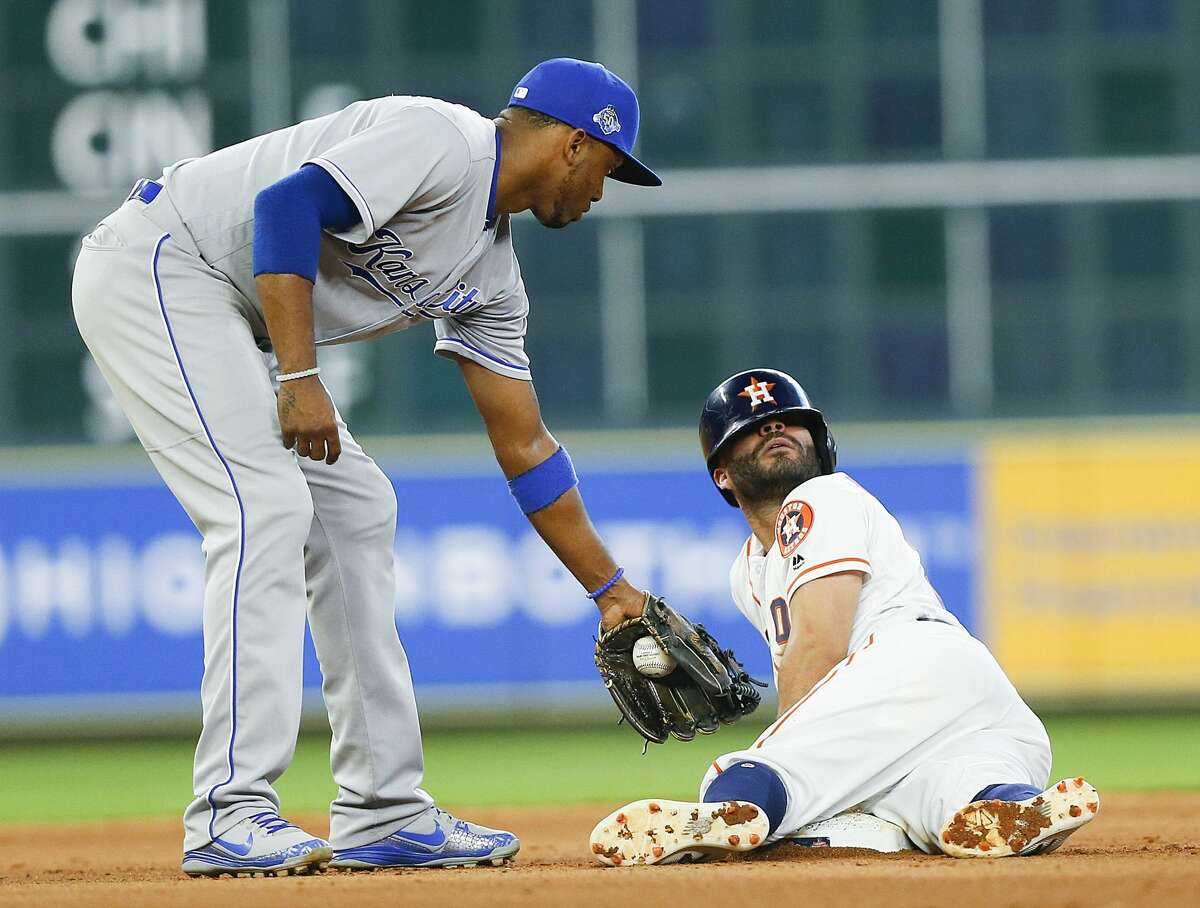 HOUSTON, TX - JUNE 23: Jose Altuve #27 of the Houston Astros slides into second base for a double ahead of the tag by Alcides Escobar #2 of the Kansas City Royals in the fourth inningat Minute Maid Park on June 23, 2018 in Houston, Texas. (Photo by Bob Levey/Getty Images)