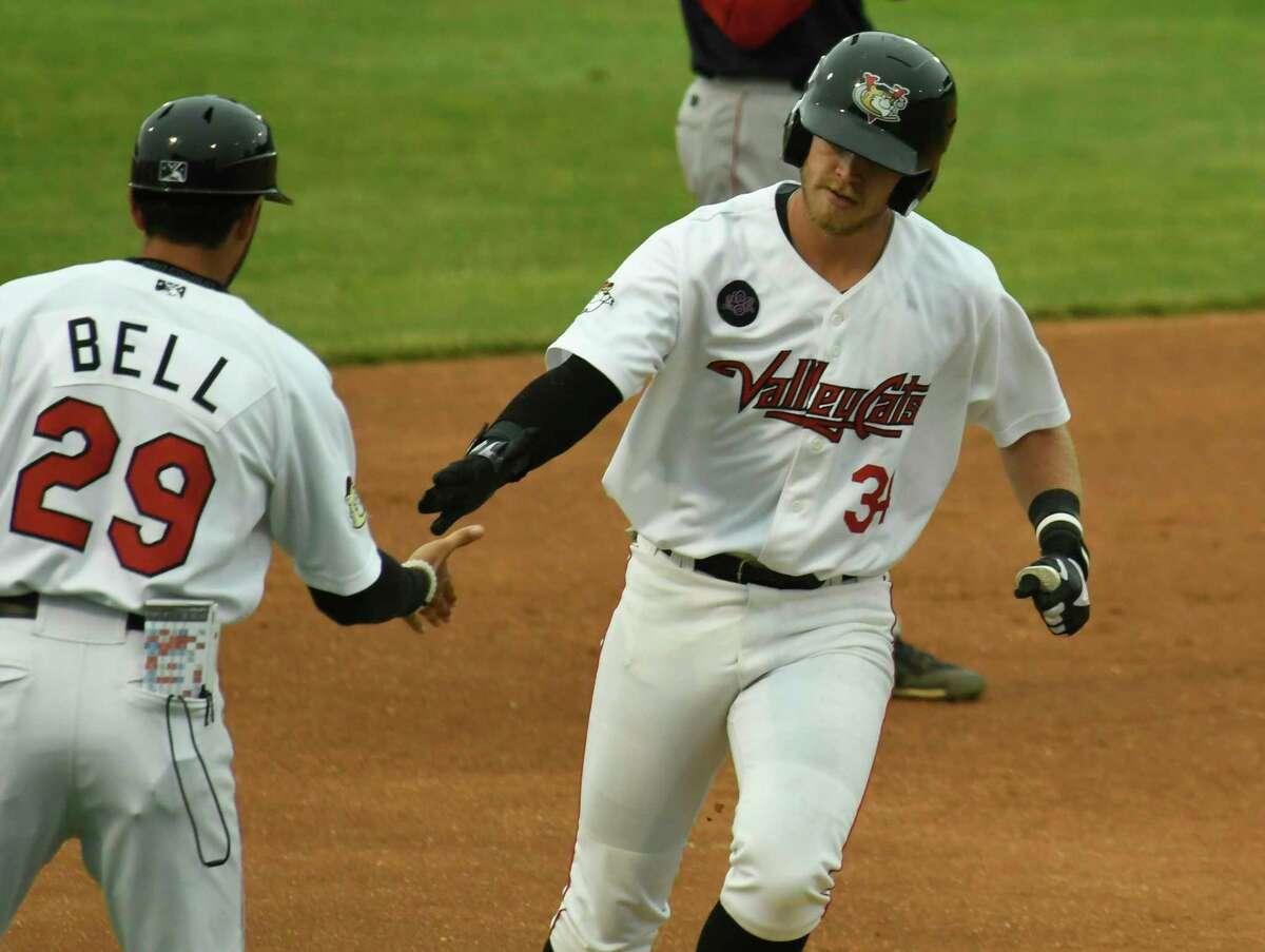 Valley Cats manager Jason Bell (29) sticks his hand out for a hi-five from first baseman Seth Beer (34) after his homerun hit, which brought himself and Jeremy Pena (not seen) during a game against the Lowell Spinners at Hudson Valley Community College in Troy, N.Y., on Saturday, Jun. 23, 2018. (Jenn March, Special to the Times Union)
