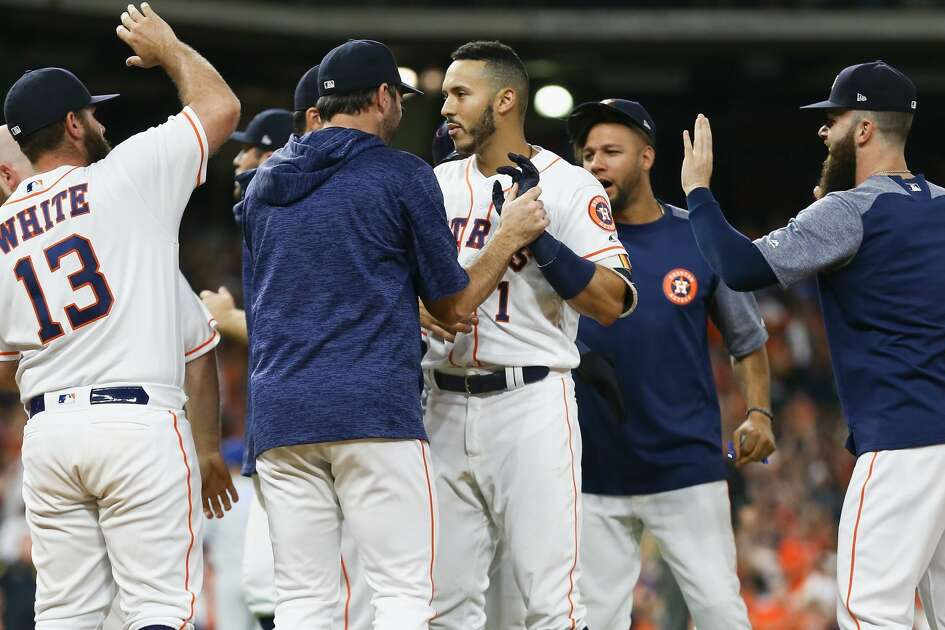 HOUSTON, TX - JUNE 23:  Carlos Correa #1 of the Houston Astros celebrates with this teammates after hitting a walkoff single in the twelfth inning for a 4-3 win over thte Kansas City Royals at Minute Maid Park on June 23, 2018 in Houston, Texas.  (Photo by Bob Levey/Getty Images)
