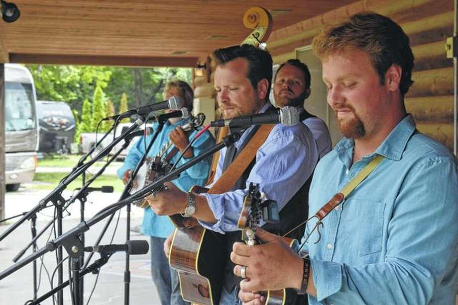 The Harmans of Bethalto perform Saturday at the 11th annual Crazy Horse Campground Bluegrass Music Festival north of Jacksonville. Photo:       Greg Olson | Journal-Courier