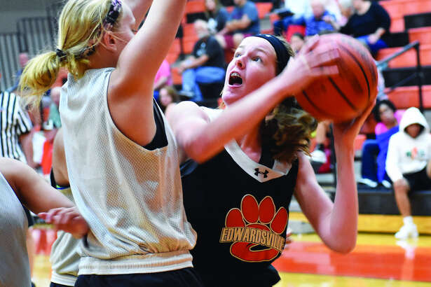 Edwardsville sophomore forward Katelynne Roberts, right, looks to take the ball to the basket during a scrimmage against Highland on Friday inside Lucco-Jackson Gymnasium.