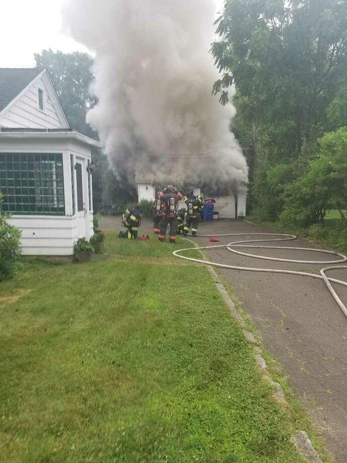A garage on Fairlawn Avenue in Danbury caught on fire Sunday morning. Photo: / Contributed Photo /Danbury Fire Department
