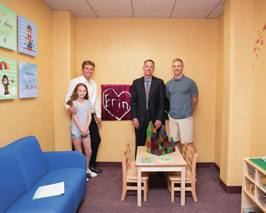 Members of the late Erin Reilly's family gather in the Madison County Courthouse's Children's Room, which was dedicated in her honor. Photo:       For The Telegraph
