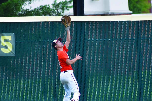 Edwardsville left fielder Joe Toscano makes a catch near the fence during Saturday morning's game against Inside Edge 17 at Tom Pile Field.