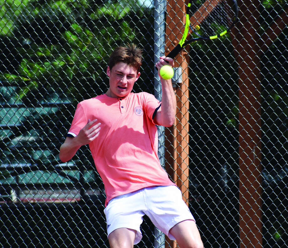 Rory Sutter hits a forehand shot during the championship match of the 18 singles at the EHS Tennis Center.