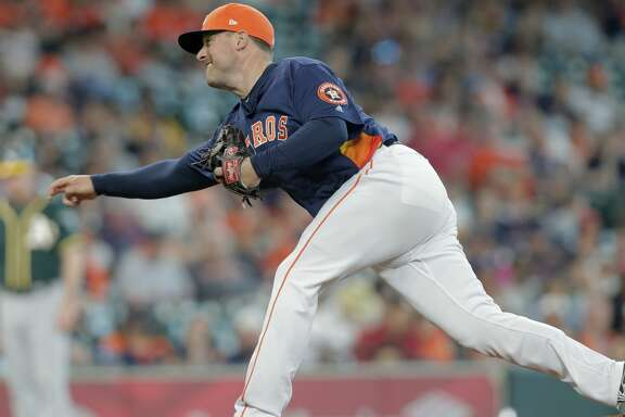Houston Astros relief pitcher Joe Smith (38) pitches in the top of the ninth inning against Oakland Athletics at Minute Maid Park on Sunday, April 29, 2018, in Houston. Astros won the game 8-4 and the series 2-1.  ( Elizabeth Conley / Houston Chronicle )