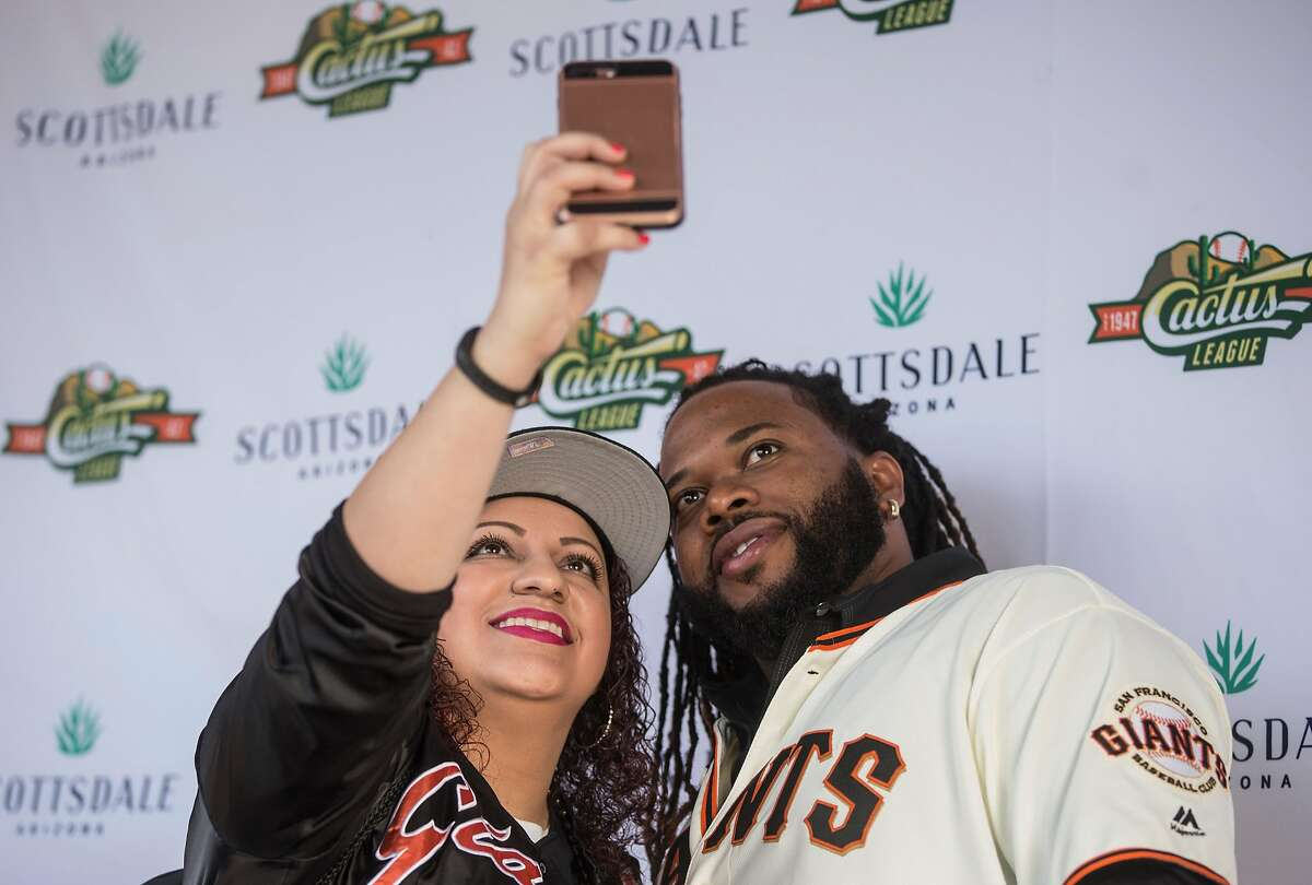 A woman takes a selfie with San Francisco Giants pitcher Johnny Cueto during San Francisco Giants FanFest at AT&T Park Saturday, Feb. 10, 2018 in San Francisco, Calif.