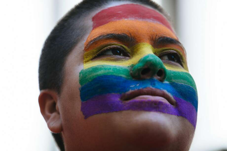 Maria Mercado watches the floats during the San Francisco Pride Parade in San Francisco, Calif., on Sunday, June 24, 2018. Photo: Mason Trinca / Special To The Chronicle