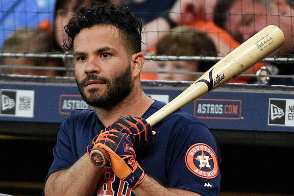 Houston Astros designated hitter Jose Altuve watches from the dugout during the first inning of a baseball game against the Kansas City Royals, Sunday, June 24, 2018, in Houston. (AP Photo/Eric Christian Smith)