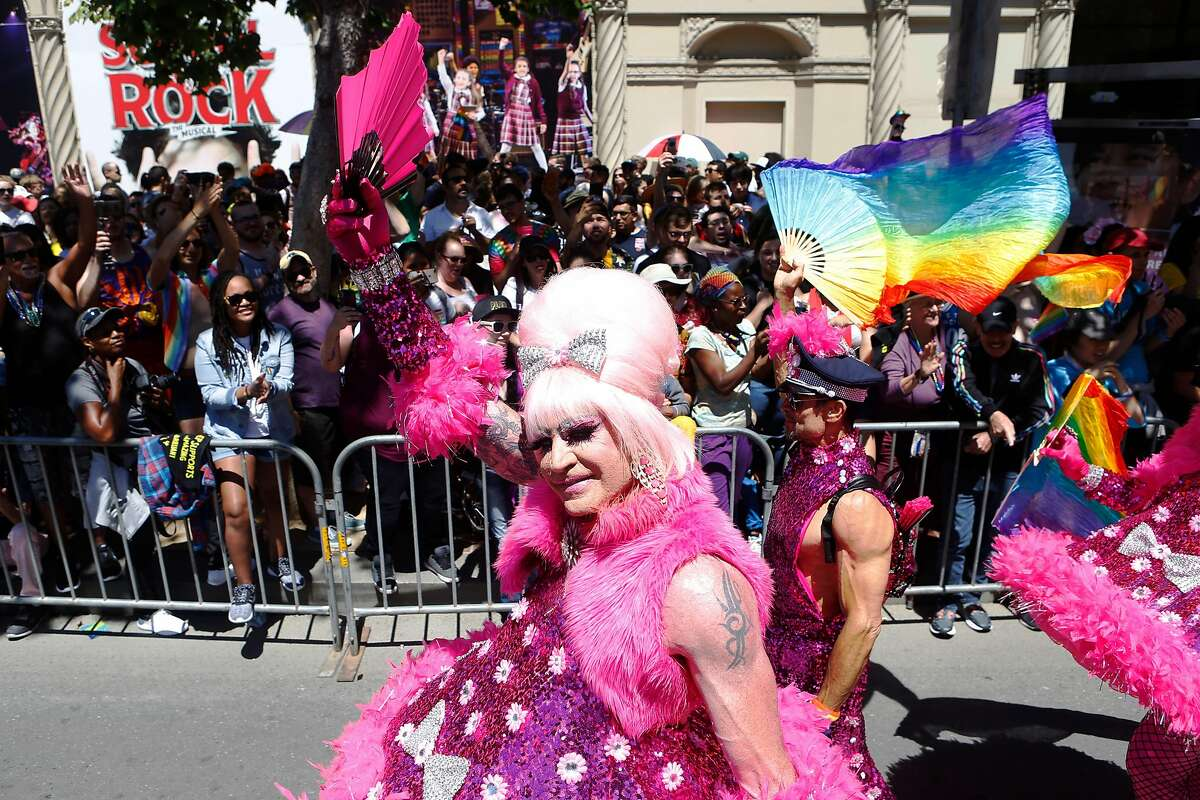 Pride Parade performers march down Market Street on Sunday, June 24, 2018 in San Francisco, Calif.