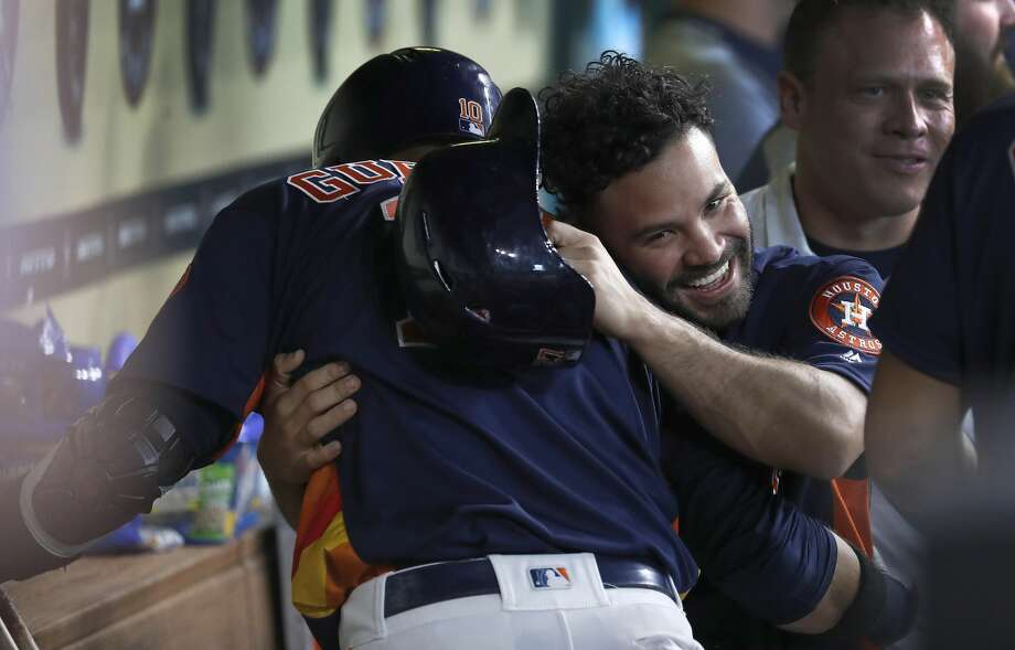 Houston Astros Jose Altuve gives Yuli Gurriel a hug as they celebrated Gurriel's grand slam home run during the second inning of an MLB game at Minute Maid Park, June 24, 2018, in Houston.   ( Karen Warren  / Houston Chronicle ) Photo: Karen Warren/Houston Chronicle