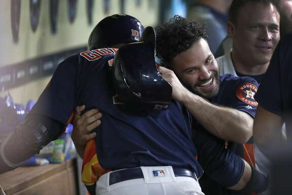 Houston Astros Jose Altuve gives Yuli Gurriel a hug as they celebrated Gurriel's grand slam home run during the second inning of an MLB game at Minute Maid Park, June 24, 2018, in Houston.   ( Karen Warren  / Houston Chronicle )