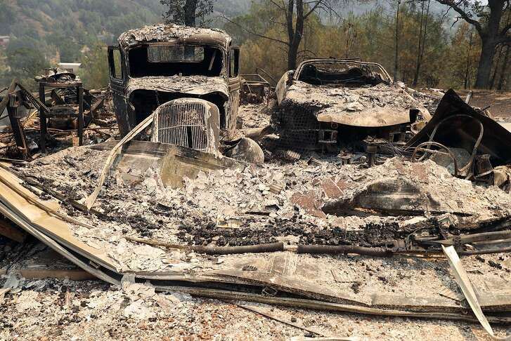 Two burned vehicles along Pueblo Trail as Cal Fire battles the Pawnee Fire in Lake County, Calif. on Sunday, June 24, 2018.
