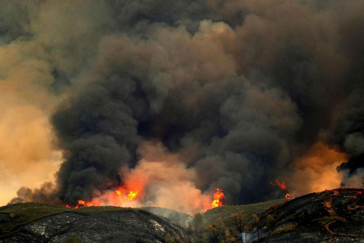 Pawnee Fire burns on hilltops in Lake County, Calif. on Sunday, June 24, 2018.