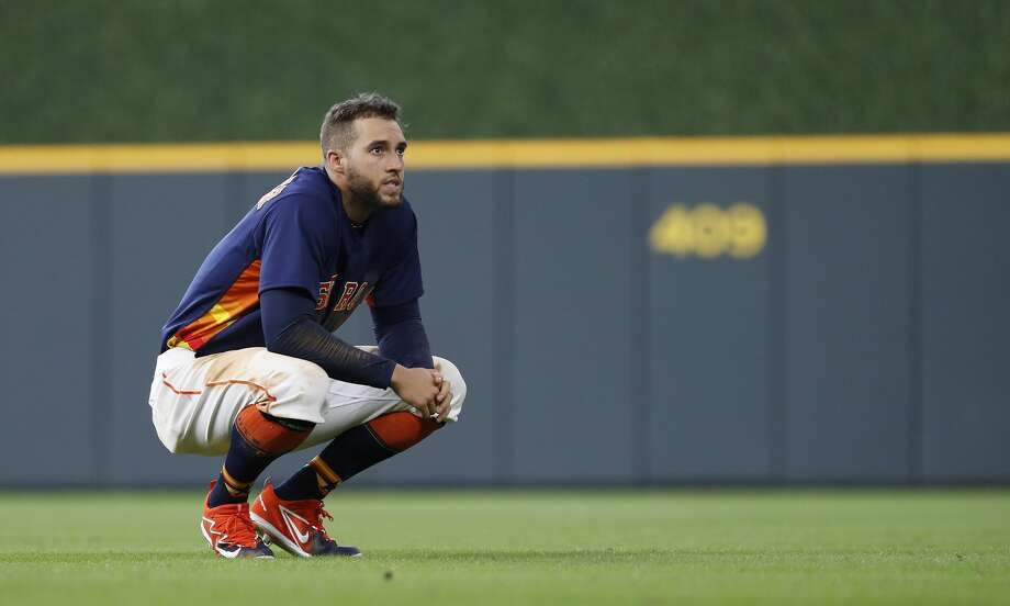 Houston Astros George Springer (4) waits on the field for his glove after grounding out to end the fifth inning of an MLB game at Minute Maid Park, June 24, 2018, in Houston.   ( Karen Warren  / Houston Chronicle ) Photo: Karen Warren/Houston Chronicle