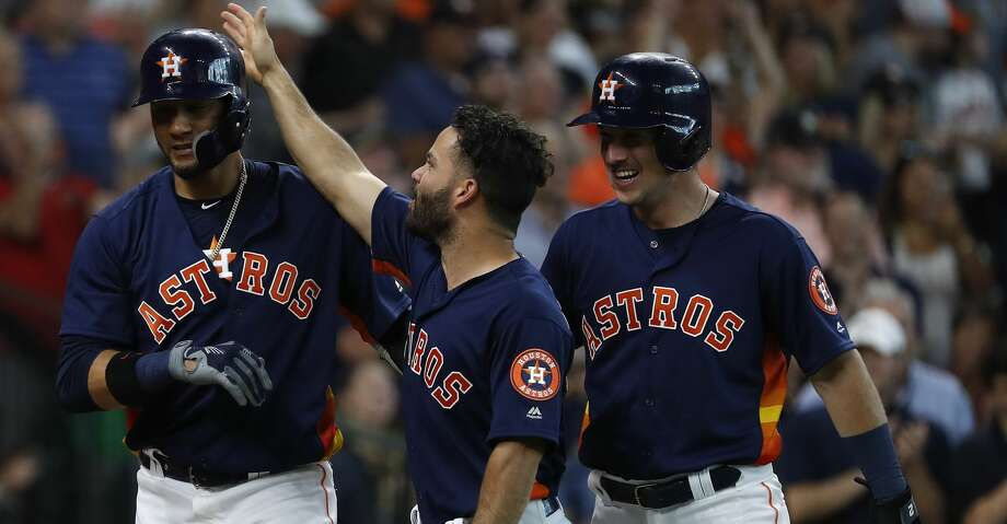 Houston Astros Yuli Gurriel (10) celebrates with Jose Altuve and Alex Bregman after he hit his grand slam home run during the second inning of an MLB game at Minute Maid Park, June 24, 2018, in Houston.   ( Karen Warren  / Houston Chronicle ) Photo: Karen Warren/Houston Chronicle