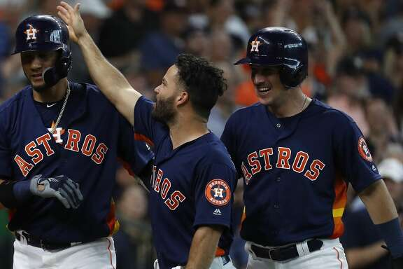 Houston Astros Yuli Gurriel (10) celebrates with Jose Altuve and Alex Bregman after he hit his grand slam home run during the second inning of an MLB game at Minute Maid Park, June 24, 2018, in Houston.   ( Karen Warren  / Houston Chronicle )