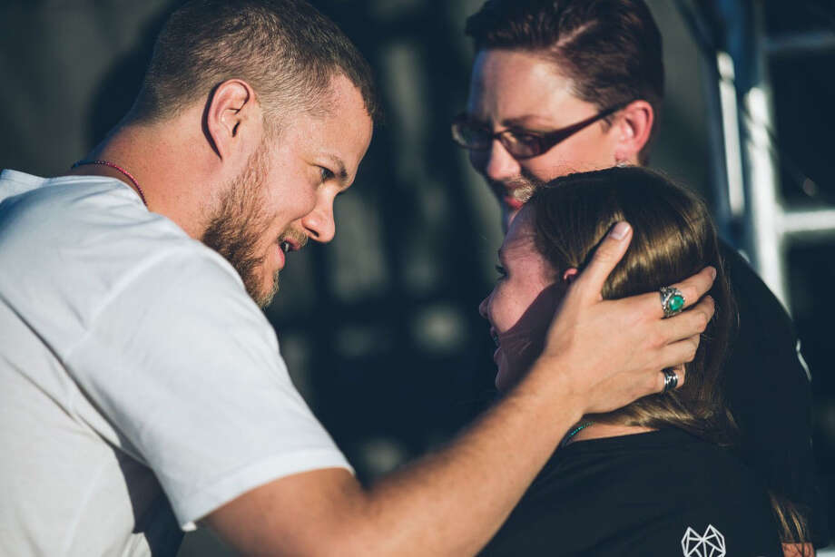 Dan Reynolds greets Savannah and her mother, Heather Kester, after Savannah's speech at the 2017 LoveLoud Festival in Orem, Utah. photo: courtesy of HBO / Courtesy of HBO