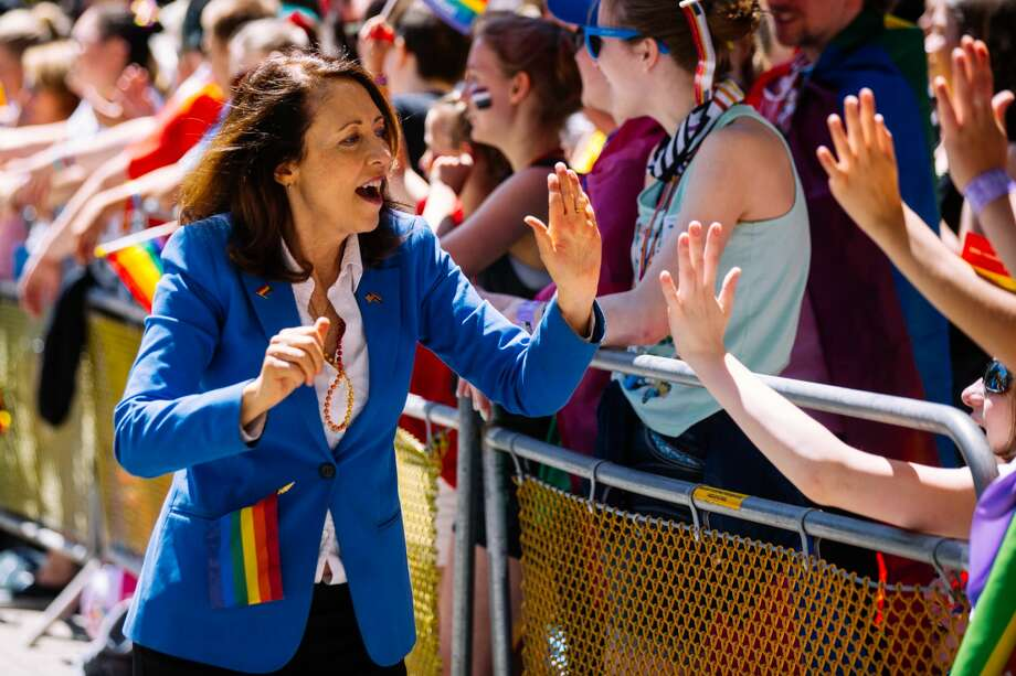 Sen. Maria Cantwell interacts with spectators at the 2018 Seattle Pride Parade. Photo: Joshua Lewis