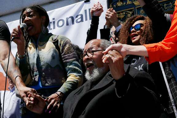 Glide Memorial United Methodist Church Cecil Williams (center) embraces supporters during a rally for Glide Memorial Church outside City Hall, Thursday, June 21, 2018, in San Francisco, Calif.