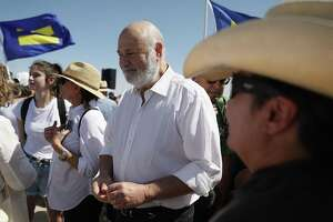 Filmmaker Rob Reiner joins protesters near the tent encampment recently built at the Tornillo-Guadalupe Port of Entry on June 24, 2018 in Tornillo, Texas. Reiner and his family joined others to protest the separation of children from their parents after they were caught entering the U.S. under the administration's zero tolerance policy.