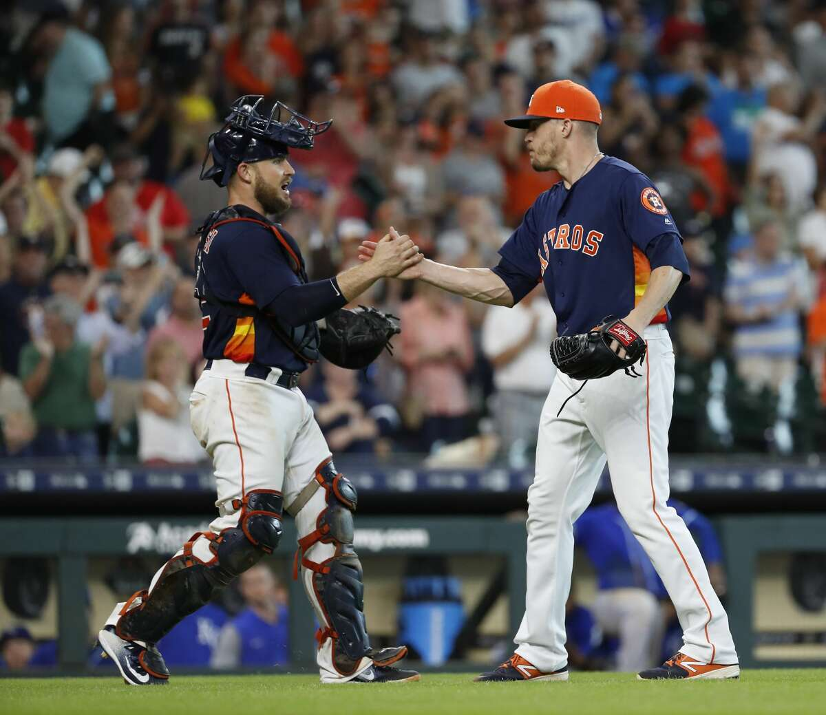 Houston Astros relief pitcher Ken Giles (53) celebrates with catcher Max Stassi (12) after the Astros 11-3 win over the Kansas City Royals during the ninth inning of an MLB game at Minute Maid Park, June 24, 2018, in Houston. ( Karen Warren / Houston Chronicle )