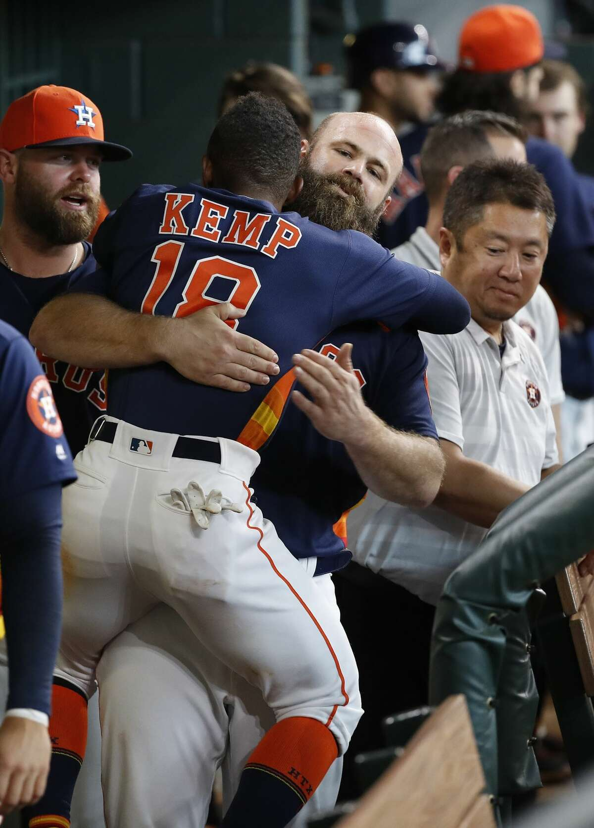 Houston Astros Tony Kemp (18) jumps on Evan Gattis (11) in the dugout after Gattis' home run during the eighth inning of an MLB game at Minute Maid Park, June 24, 2018, in Houston. ( Karen Warren / Houston Chronicle )