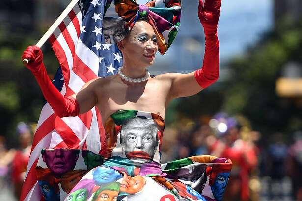 Khuong Lam wears a Donald Trump-themed dress while marching during the San Francisco gay pride parade in San Francisco, California on June, 24, 2018. / AFP PHOTO / Josh EdelsonJOSH EDELSON/AFP/Getty Images