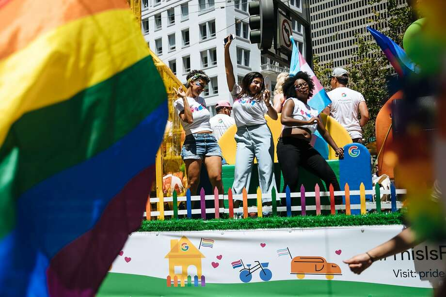 Dancers perform on the Google float in the 2018 Pride Parade. Google is under fire for failing to remove videos by a right-wing content creator accused of homophobic slurs. Photo: Mason Trinca / Special To The Chronicle 2018