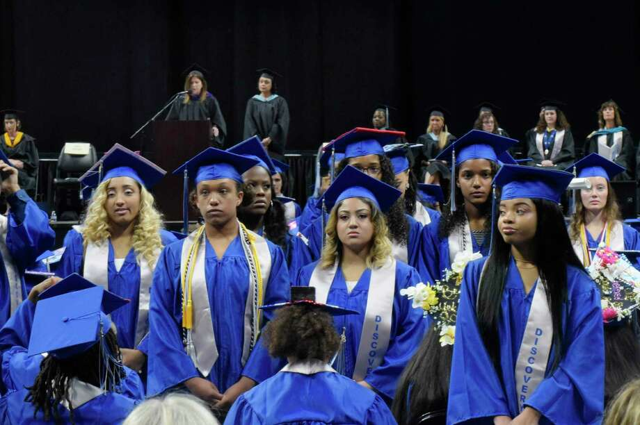 A number of Albany High School graduates stand and turn their back on Sue Adler, background left, the president of the Board of Education, as she gave a speech at the Albany High School graduation at the Times Union Center on Sunday, June 24, 2018, in Albany, N.Y.  (Paul Buckowski/Times Union) Photo: Paul Buckowski, Albany Times Union / (Paul Buckowski/Times Union)