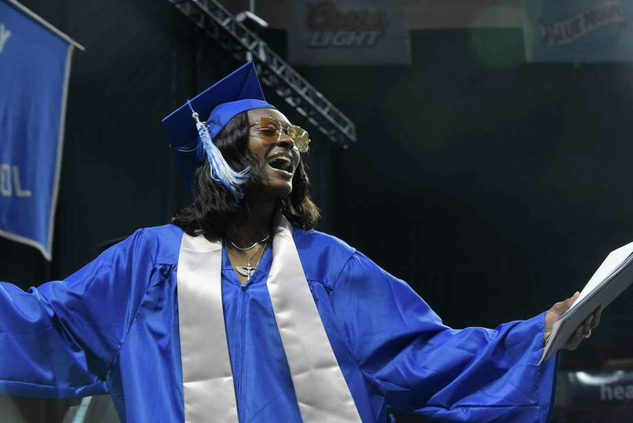Graduate Khadijah Tillery celebrates after receiving her diploma at the Albany High School graduation at the Times Union Center on Sunday, June 24, 2018, in Albany, N.Y.  (Paul Buckowski/Times Union) Photo: Paul Buckowski, Albany Times Union / (Paul Buckowski/Times Union)