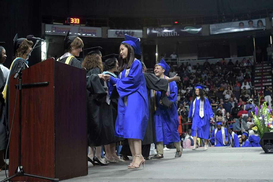 Albany High School graduates walk across the stage to receive their diplomas during their graduation at the Times Union Center on Sunday, June 24, 2018, in Albany, N.Y.  (Paul Buckowski/Times Union) Photo: Paul Buckowski, Albany Times Union / (Paul Buckowski/Times Union)