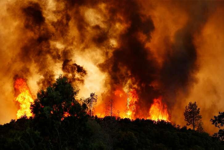 The Pawnee Fire burns along Spring Valley Road in Lake County, Calif. on Sunday, June 24, 2018.