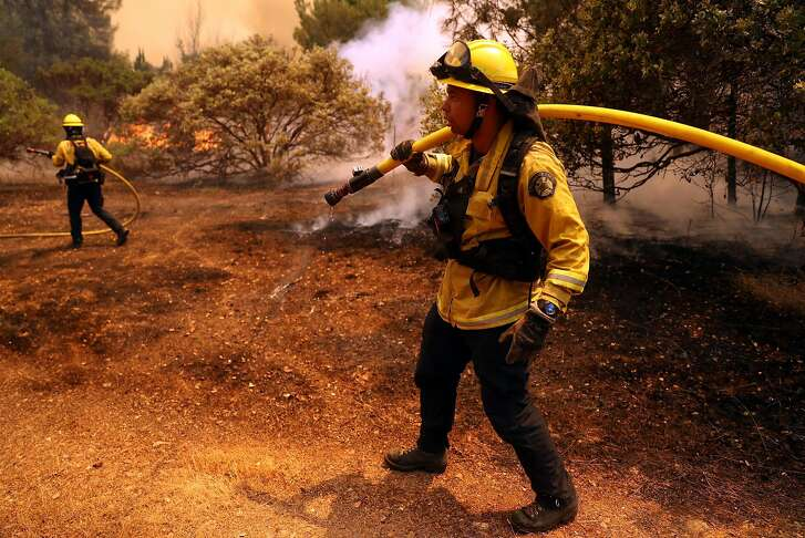 Fremont Fire Department members battle the Pawnee Fire along Spring Valley Road in Lake County, Calif. on Sunday, June 24, 2018.